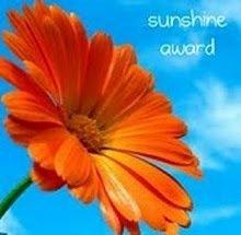http://data0.eklablog.com/hauteclaire/perso/sunshine-award.jpg